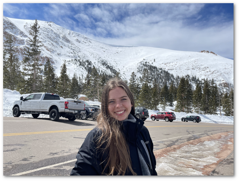 Kellie Smith in front of snow-capped mountains